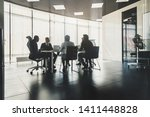 silhouettes of people sitting... | Shutterstock . vector #1411448828