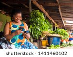 African Woman Using Her Phone...