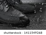 Small photo of Galoshes And Water Drops, Waterproof Shoes