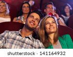 happy young couple watching... | Shutterstock . vector #141164932