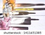 unisex perfume bottles on white ...   Shutterstock . vector #1411651385