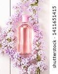 pink bottle of women's perfume...   Shutterstock . vector #1411651415