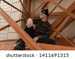 nice young hipster man in black ... | Shutterstock . vector #1411691315
