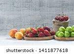 summer fruits  green plum  red... | Shutterstock . vector #1411877618