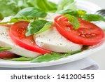 caprese salad with mozarella... | Shutterstock . vector #141200455