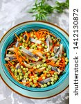 Stock photo salad of salted herring carrots and green peas cold appetizer of salted herring 1412130872