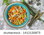 Stock photo salad of salted herring carrots and green peas cold appetizer of salted herring 1412130875
