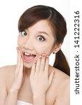 beautiful young woman touching... | Shutterstock . vector #141222316