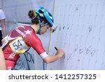Female Cyclist Signing The...