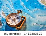 Beautiful golden ancient compass over a map containing Madagascar and a part of the Indian Ocean at the Tropic of Capricorn