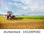 farmer passing the harrow in his fields