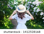 Girl In A Straw Hat With A Blue ...
