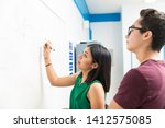 high school students writing on ... | Shutterstock . vector #1412575085