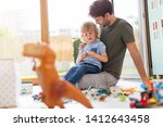 father playing with his little... | Shutterstock . vector #1412643458