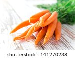 Fresh Young Carrots On Wooden...
