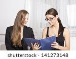 two beautiful businesswomen...   Shutterstock . vector #141273148