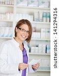 smiling pharmacist chemist... | Shutterstock . vector #141294316
