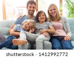portrait of happy family... | Shutterstock . vector #1412992772