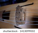 Small photo of macro of strings and bridge of the viola da gamba