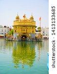 Small photo of Amritser, Punjab / India - May 30 2019: The Harmandar Sahib also known as Darbar Sahib, is a Gurdwara located in the city of Amritsar, Punjab, India. It is the preeminent pilgrimage site of Sikhism.