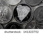 Small photo of assorted coins - central coin minting shows Arthur Schopenhauer