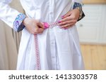 the hands of a slim woman in... | Shutterstock . vector #1413303578
