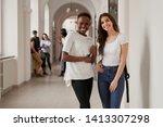 african and caucasian girls... | Shutterstock . vector #1413307298