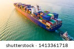 Small photo of Container ship sailing through the ocean, Business logistics and transportation of International container ship in the ocean freight transportation, Aerial view Container loading cargo freight ship.