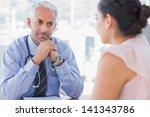 serious doctor listening to...   Shutterstock . vector #141343786