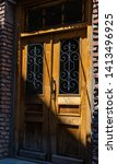 door with forged iron in old... | Shutterstock . vector #1413496925