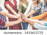young friends stacking hands... | Shutterstock . vector #1413612725
