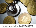 Bitcoins And Stethoscope On A...