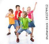 happy children dancing on a... | Shutterstock . vector #141379912