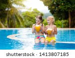 child with coconut drink in... | Shutterstock . vector #1413807185