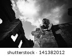 Fantasy style portrait of the scary woman in the ruins, black and white shot - stock photo
