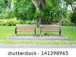 wood bench in public park | Shutterstock . vector #141398965