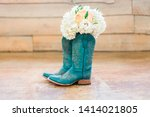 Bridal Bouquet in Blue Cowboy Boots - stock photo