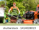 Professional Garden Maintenance. Caucasian Gardener in His 30s and His Company Landscaping Equipment.  - stock photo