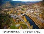 Aerial photo of the city of Rogue River Oregon, Interstate highway I5 and the concrete arch bridge over the Rogue River