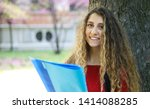 female student holding a book... | Shutterstock . vector #1414088285