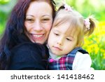 bright picture of hugging... | Shutterstock . vector #141418462