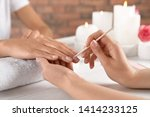 manicurist working with client... | Shutterstock . vector #1414233125