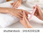 Manicurist Filing Client's...
