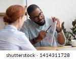 male black coworker showing... | Shutterstock . vector #1414311728