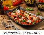 cod in italian in tomatoes with ... | Shutterstock . vector #1414325072