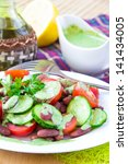 fresh summer salad with... | Shutterstock . vector #141434005