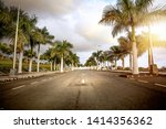 sumer road and coconuts palms  | Shutterstock . vector #1414356362