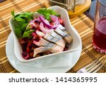 Stock photo russian vinaigrette salad with diced vegetables and roots served with pickled herring 1414365995