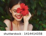 Happy Woman With A Red Flower...