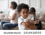 Small photo of Portrait of upset little african child boy holding toy looking at camera, sad sensitive small mixed race kid feel lonely hurt suffer from family conflicts fights, parents divorce, children custody